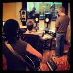 Leslie Hunt recording acoustic guitar